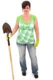 Femme avec des gants de pelle et de jardin photographie stock libre de droits