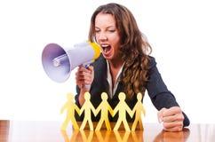 Femme avec des gens de coupure de haut-parleur et de papier Image stock
