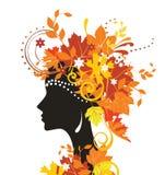Femme avec des lames d'automne Photos stock