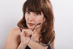Femme avec des lunettes Photographie stock libre de droits