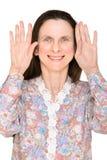 Femme avec des mains vers le haut Photos stock