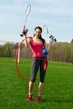 Femme avec des matériels de sport Images stock