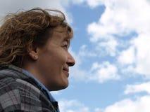 Femme avec des nuages Photo stock