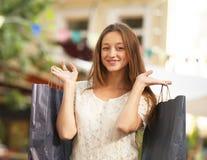 Femme avec des paniers Images stock