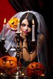 Femme avec des potirons de Halloween Photo libre de droits