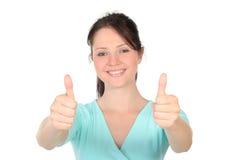 Femme avec des pouces vers le haut Photographie stock libre de droits