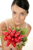 Femme avec des radis Photographie stock libre de droits