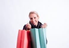 Femme avec des sacs à provisions Photographie stock libre de droits