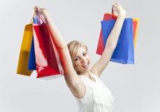 Femme avec des sacs à provisions Photo stock