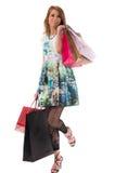 Femme avec des sacs ? provisions sur le fond blanc Photographie stock