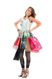 Femme avec des sacs ? provisions sur le fond blanc Image stock