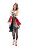 Femme avec des sacs ? provisions sur le fond blanc Photo stock