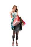 Femme avec des sacs ? provisions sur le fond blanc Photos libres de droits