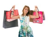 Femme avec des sacs ? provisions sur le fond blanc Photos stock