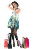Femme avec des sacs ? provisions sur le fond blanc Photographie stock libre de droits