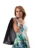 Femme avec des sacs ? provisions sur le fond blanc Images stock