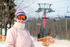 Femme avec des skis Photographie stock