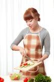 Femme avec des tomates Photo stock