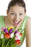 Femme avec des tulipes Photos libres de droits