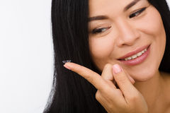 Femme avec des verres de contact Photographie stock