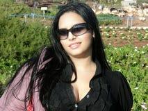 Femme avec des verres de soleil Photos stock