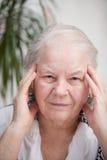 Femme avec douleur de mal de tête Photographie stock libre de droits
