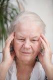 Femme avec douleur de mal de tête Images libres de droits