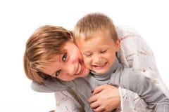 Femme avec du charme avec un fils Photos stock