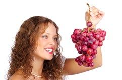 Femme avec du raisin photographie stock