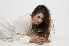 Femme avec du vin Photos stock