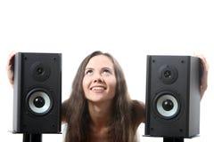 Femme avec haut-parleurs Images stock