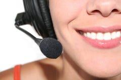 Femme avec l'écouteur Photographie stock