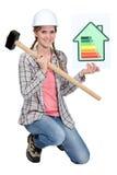 Femme avec l'affiche de notation d'énergie photographie stock libre de droits