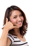 Femme avec l'appel nous signe de main Photo libre de droits
