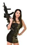 Femme avec l'arme à feu Photo stock