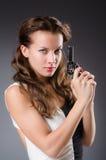 Femme avec l'arme à feu contre Photos libres de droits