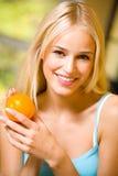 Femme avec l'orange Photos libres de droits
