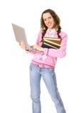 Femme avec l'ordinateur portatif et la pile des livres Photo stock