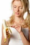 Femme avec la banane Photos stock