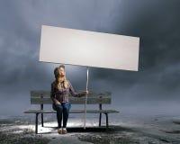 Femme avec la bannière Photographie stock