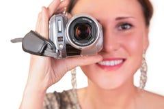 Femme avec la caméra vidéo Photographie stock