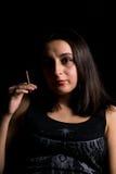 Femme avec la cigarette Photographie stock libre de droits