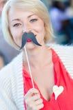 Femme avec la fausse moustache Photographie stock libre de droits