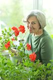 Femme avec la fleur rouge Photos libres de droits