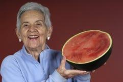 Femme aîné avec la pastèque Image libre de droits