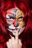 Femme avec la peinture de visage Photos stock
