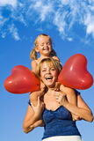 Femme avec la petite fille et les ballons Photo libre de droits