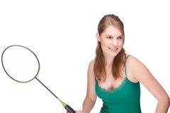 Femme avec la raquette de badminton Photographie stock