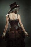 Femme avec la robe de steampunk Photographie stock