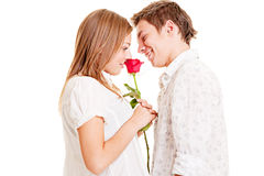 Femme avec la rose et l'homme de smiley Photos libres de droits
